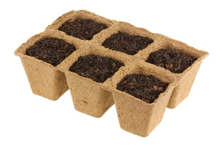 starter: Eco Friendly and Biodegradable Plant Pots for growing seeds, Isolated on white  Stock Photo