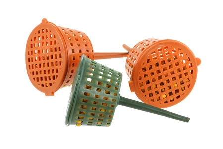 farming tools: Close up of Slow-release Fertilizer Baskets, They are not water-soluble and they reduce fertilizer burn