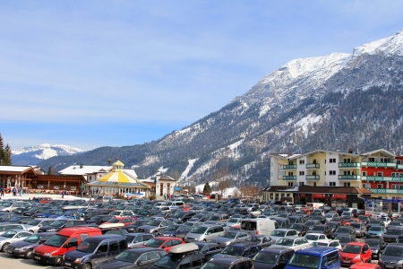 new car lots: Achenkirch, Austria - March 17, 2013   Many cars parking at the base station at the Ski Lift Christlum Express during the ski seasons  in Achenkirch, Austria   Editorial