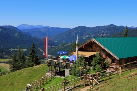 locals: Tyrol, Austria - August 18, 2012   Zohreralm, Restaurant at 1334M  high overlooking Achenkirch and the Bavarian mountains  Locals and tourists need to trek through wild forest to Zohreralm