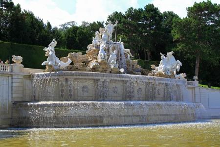 schloss schoenbrunn: Vienna, Austria - August 9, 2012   Statue of Neptune's entourage at the Neptune Fountain at Schloss Schoenbrunn Palace, A UNESCO World Cultural Heritage in Vienna - Austria Editorial
