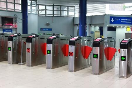 Kuala Lumpur, Malaysia - August 11, 2013   Ticket gate at Masjid Jamek Light Rapid Transit interchange station in Kuala Lumpur, Malaysia Editorial