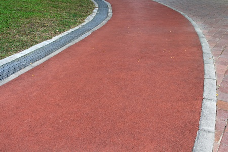 garden path: Red Rubberized Running Track, Jogging Path in the park in Asia Stock Photo