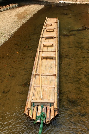 Hand-made bamboo raft waiting for tourists to visit the cave photo