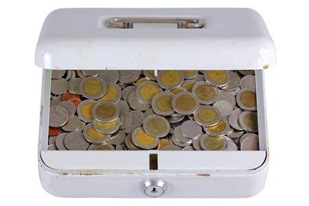 An old metal box full of Thai Baht coins photo
