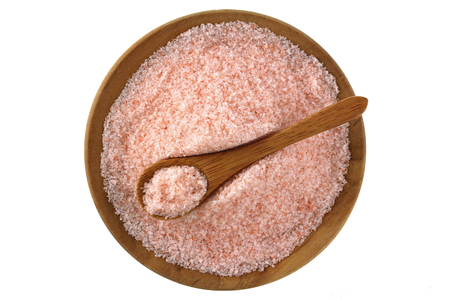 Fine grains of Pink Himalayan salt in a wooden bowl photo