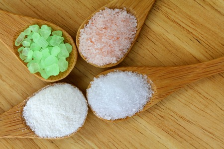 himalayan salt: Pink Himalayan Salt, Sea Salt, Mountain Salt and Epsom Salt in a wooden spoon
