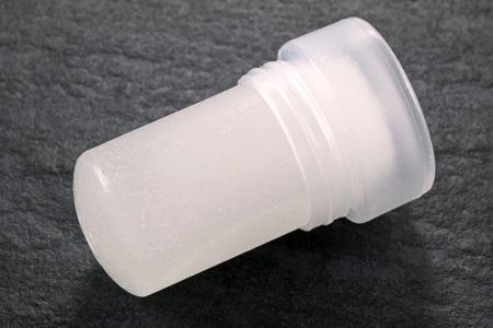 underarm: Natural alum crystal underarm deodorant on black background