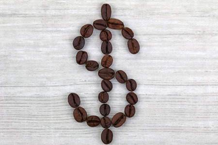 Coffee beans in a shape of Dollar sign photo