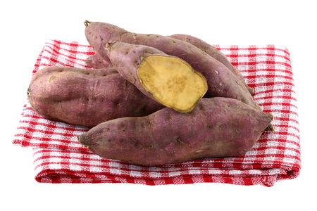 sweet potato: Raw Sweet Potato with dirt on skin, isolated on white
