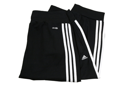 cuffed: BANGKOK, THAILAND - JULY 2014   Folded Adidas ClimaLite cotton cuffed workout pants for woman isolated on white on 12 July 2014 in Bangkok, Thailand  ClimaLite is a lightweight synthetic fabric that wicks moisture and sweat from the body for easy evaporat