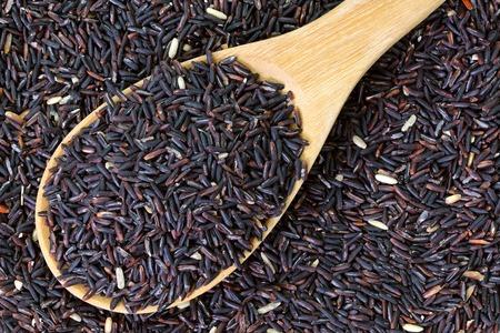 Closeup of raw purple Riceberry rice, it is a crossbred between Thai Hom Nil (black jasmine rice) and white Jasmine rice photo