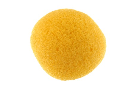 sponge: A round yellow natural facial Sponge made of vegetable fiber, Konjac, isolated on white Stock Photo