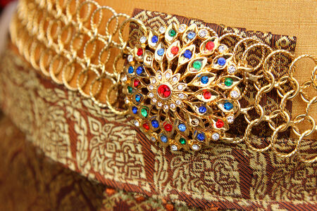 antique jewelry: A closeup of a traditional Thai belt decorated with colorful gemstones Stock Photo