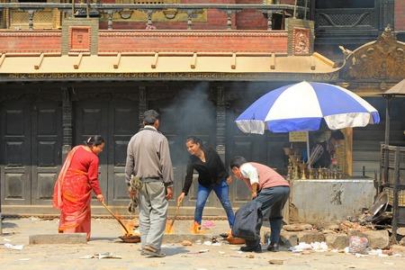 worshipers: Nepalese worshipers are giving religious offerings to Akash Bhairav, Hindu deity, at Akash Bhairav Temple in Kathmandu, Nepal Editorial