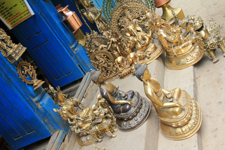 deities: Buddha images and other Hindu deities made of Brass and copperware for sale in Patan, Nepal