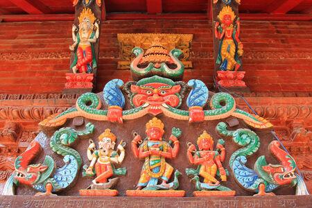 shree: Detailed of Hindu deities at the entrance panel of the Shree Kumari shrine in kathmandu, Nepal Editorial