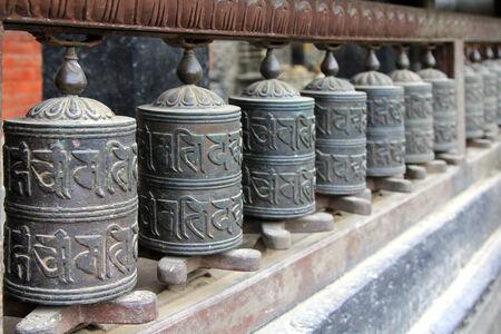 kathmandu: Praying wheels at Vidhadhar Varma Sanskarita Yasodhara Mahavihar, known as Bubahal, in Patan, Nepal