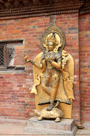 Statue of the river goddess Ganga on a tortoise at Mul Chowk, Royal Palace in Patan, Nepal. The Ganga river is worshipped by Hindus, believing that bathing in the river will remiss karma, sin and release themselves from the cycle of rebirth.