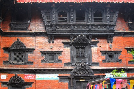 KATHMANDU, NEPAL - APRIL 2014 : The Kumari Ghar (Kumari Chowk) which was built in 1757, houses the Kumari Devi on 12 April 2014 in Kathmandu, Nepal. Kumari is a young girl who is believed to be the incarnation of the demon-slaying Hindu goddess Durga.  Editorial