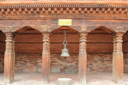 An ancient bell hanging at Patan Museum in Patan, Nepal. Patan Museum is an old residential court of Patan Darbar, one of the royal palaces of the former Malla kings of the Kathmandu Valley. Editorial