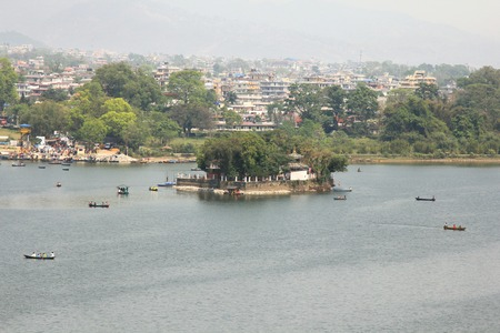 phewa: POKHARA, NEPAL - APRIL 2014 : The Taal Barahi Temple on an island in Phewa Lake on 15 April 2014 in Pokhara city, Nepal. Phewa Lake is also called Phewa Tal or Fewa Lake.  It is a freshwater lake in the south of the Pokhara Valley.