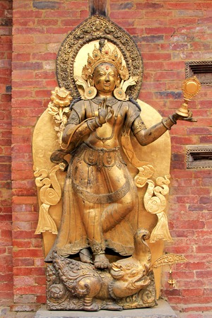 PATAN, NEPAL - APRIL 2014 : Statue of the river goddess Ganga standing on a Makara at Mul Chowk, Royal Palace in Patan, Nepal on 13 April 2014. The Ganga river is worshipped by Hindus, believing that bathing in the river will remiss karma, sin and release