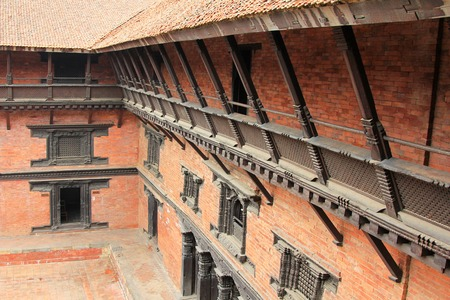 PATAN, NEPAL - APRIL 2014 : View of the external corridor on the balcony at Patan Museum in Patan, Nepal on 13 April 2014. Patan Museum is an old residential court of Patan Darbar, one of the royal palaces of the former Malla kings of the Kathmandu Valley