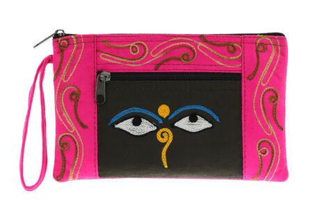 nepali: A small pink bag with symbol Nepali Buddha Eyes, common souvenir from Nepal Stock Photo