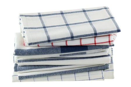 Folded kitchen towels in different patterns, isolated on white Stock Photo
