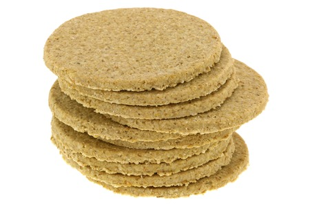 crumbly: A stack of gluten free crumbly rough Oatcakes, isolated on white background