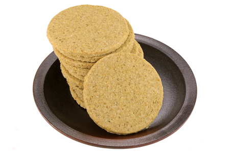 crumbly: A dish of gluten free crumbly rough Oatcakes, isolated on white background Stock Photo