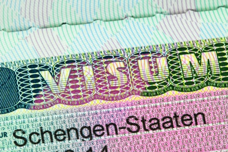 Closeup of the Schengen visa to Austria Germany with shallow DOF focusing on the word VISUM Stockfoto