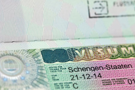 schengen: Closeup of the Schengen visa to Austria Germany with shallow DOF