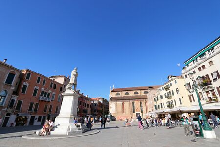 essayist: People sitting and walking around at Statue of Niccolo Tommaseo monument at Campo San Stefano in Venice, Italy on September 14, 2014. Nicolo Tommaseo was a linguist, journalist, essayist, and Italian irredentism. Editorial