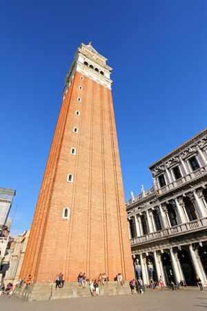 st  mark's: People walking around at St Marks Campanile Campanile di San Marco in Venice, Italy on September 14, 2014. St Marks Campanile bell tower is the 98.6m 323 ft. tall and located in the Piazza San Marco. Editorial