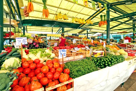 the merchant of venice: Different types of fresh fruit and vegetables for sale at the Rialto Italian market in Venice, Italy on September 15, 2014. The Rialto market has been operating for more than 700 years.