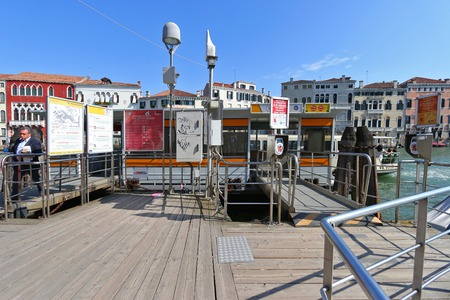 waterbus: Passengers getting out of Water taxi or Water bus Vaporetto at the pier in Venice, Italy on September 15, 2014. Different colors of line indicates different routes. There are Blue, Red, Green, and this one, Orange line