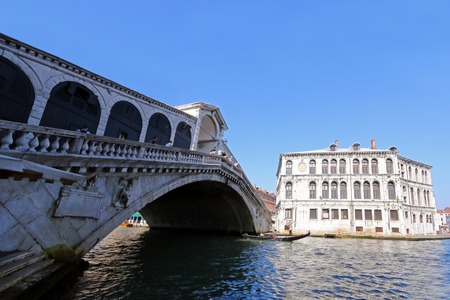rialto: The Rialto Bridge Ponte di Rialto over the Grand Canal in Venice, Italy on September 15, 2014. Rialto Bridge is a stone arch pedestrian bridge that was built in 1588 and is the oldest bridge across the canal.