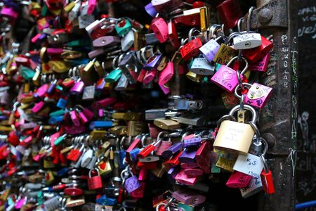 juliets: A metal gate full of colorful locks at Juliets house Casa Capuleti in Verona, Italy on September 13, 2014. Romeo and Juliet is a tragedy written by William Shakespeare.