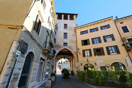 pons: Buildings at the end of the stone bridge Ponte Pietra Pons Marmoreus in Verona, Italy on September 14, 2014. It is the oldest bridge in Verona. Editorial