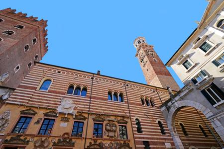 dei: The Lamberti Tower Torre dei Lamberti and Palazzo della Ragione in Verona, Italy on September 14, 2014. Palazzo della Ragione is the oldest city hall in Italy. Photo taken from Piazza dei Signori