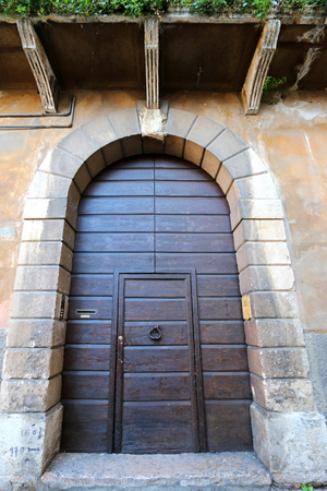 characteristic: Old entrance door with the characteristic architectural style in a historic town in Verona, Italy