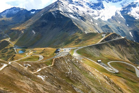 hochalpenstrasse: View of the Grossglockner High Alpine Road Hochalpenstrasse. The windy road with 36 bends that leads to the heart of the Hohe Tauern National Park in Austria. Photo taken from the Edelweiss Peak. Fuscher lacke is also visible in the photo Stock Photo
