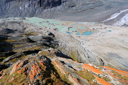 tauern: View of melted snow, moraine and crevasses at Pasterze Glacie, Grossglockner, Hohe Tauern National Park in Austria. It is the longest mountain glacier in Austria at approximately 8.4 kilometers in length.