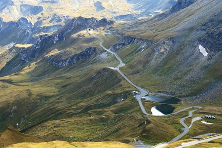 hochalpenstrasse: View of the Fuscher lake and Grossglockner High Alpine Road Hochalpenstrasse. The windy road with 36 bends that leads to the heart of the Hohe Tauern National Park in Austria. Stock Photo