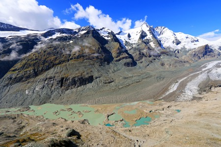approximately: The view of Pasterze Glacier at Grossglockner, Hohe Tauern National Park, Austria. It is the longest mountain glacier in Austria at approximately 8.4 kilometers in length. Stock Photo
