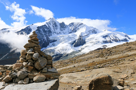 cairn: A stack of cairn at Gamsgrube Nature hiking trail along the Pasterze Glacier with the view of Grossglockner mountain range in the background, Austria