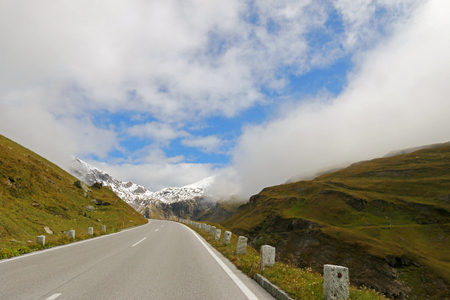 grossglockner: Foggy view of the Grossglockner High Alpine Road Hochalpenstrasse at Hohe Tauern National Park in Austria Stock Photo