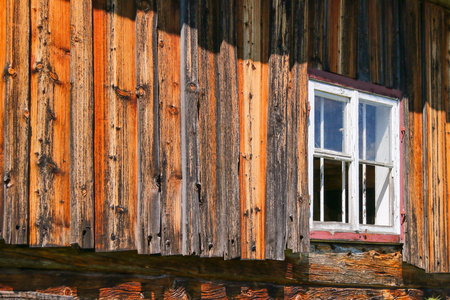 barnwood: Weathered barn with white window frame, shallow depth of field Stock Photo